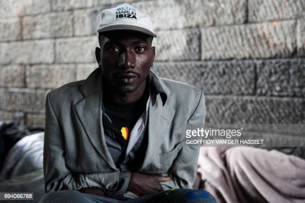 TOPSHOT A man is pictured at a migrant and refugee makeshift camp set up under the highway near Porte de la Chapelle northern Paris on June 9 2017 /...