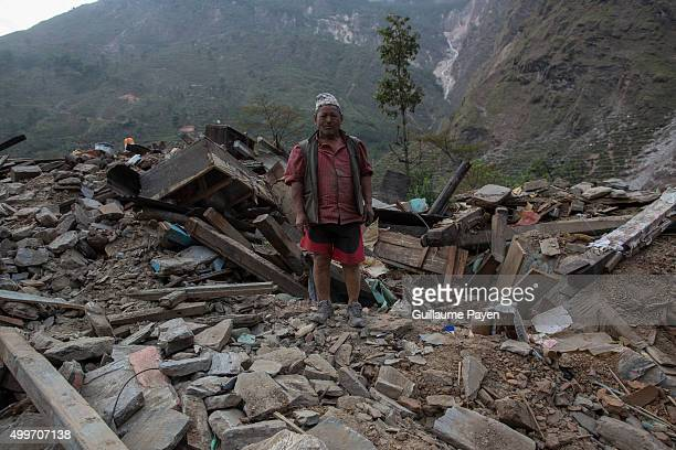 A man is pictured in the middle of his collapsed house as he's removing rubbles on the Araniko Road near the Kobani Village Isolated Nepalese...