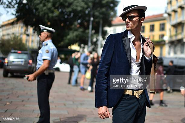 A man is pictured in the street during the 2015 Spring / Summer Milan Fashion Week on September 17 2014 in Milan AFP PHOTO / GABRIEL BOUYS