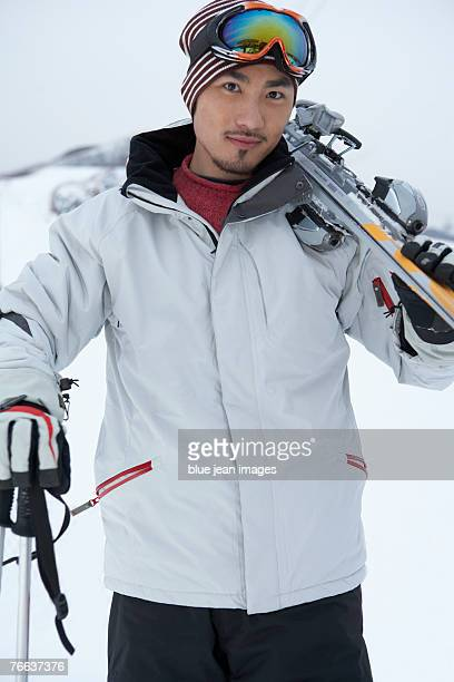 A man is preparing to ski.