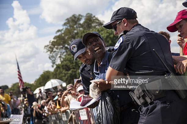 A man is removed by Capitol Police after breaking past the barricade during a rally held by the Tea Party at the United States Capitol to speak out...