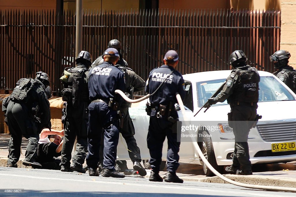 A man is removed from his vehicle by tactical police outside NSW Parliament House on Macquarie Street on December 20, 2013 in Sydney, Australia. The NSW Parliament House was locked down due to a security threat outside the building. A man has been apprehended after a stand off with riot police.
