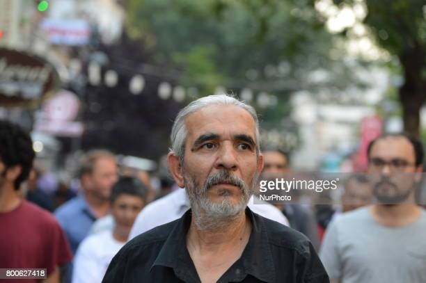 A man is seen during a march in support of sacked academic Nuriye Gulmen and primary school teacher Semih Ozakca in Ankara Turkey on June 24 2017 The...