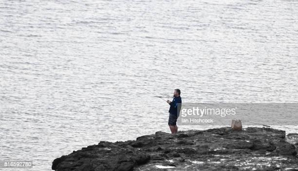 A man is seen fishing on the banks of the Fitzroy river at low tide on July 09 2017 in Rockhampton Australia