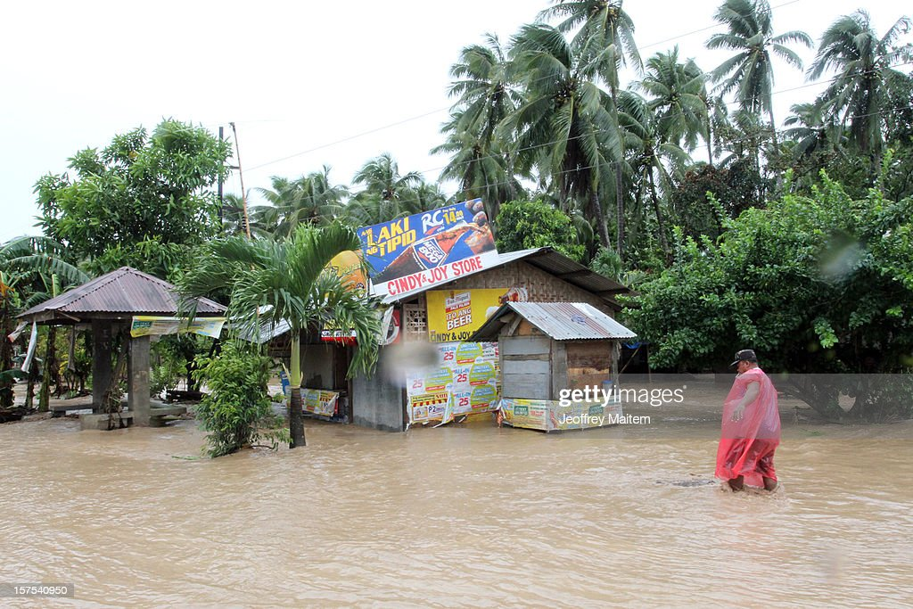 A man is seen in flooded village after heavy rains and strong winds, brought about by Typhoon Bopha, hit the township of Mabini on December 04, 2012 in the province of Compostela Valley in the southern Philippines. Typhoon Bopha made landfall in the southern Philippines earlier today, bringing heavy rain and wind gusts of 210 km/h (130mph). So far at least 40 have died and over 40,000 people have been forced into shelters.