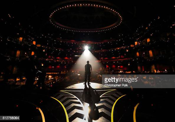 A man is seen in silhouette onstage during rehearsals for the 88th Annual Academy Awards at Dolby Theatre on February 27 2016 in Hollywood California