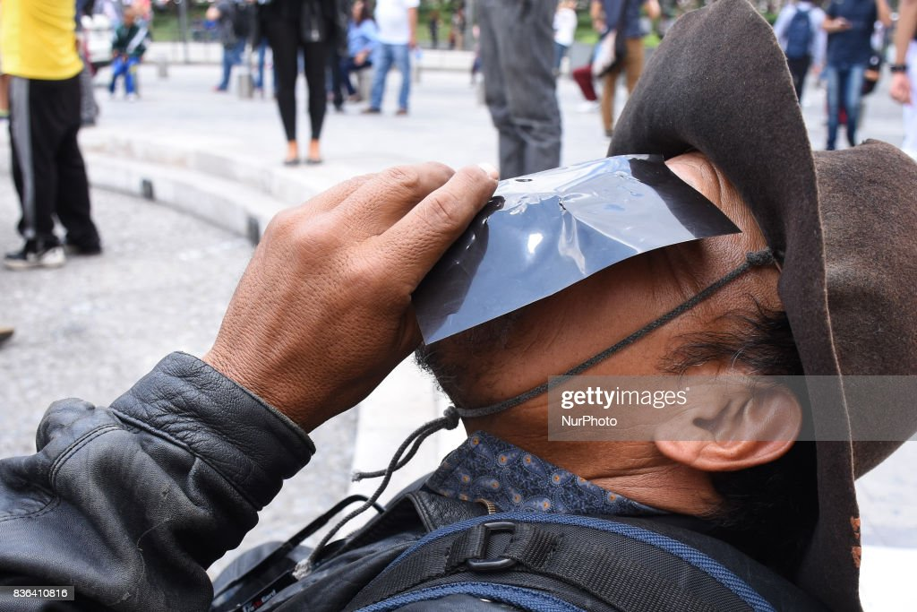 A man is seen looking the Partial Solar Eclipse viewed from the Mexico City on August 21, 2017 in Mexico City, Mexico