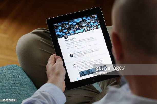 A man is seen scrolling through the Twitter timeline of former US presidential candidate Hillary Clinton on an iPad on October 24 2017