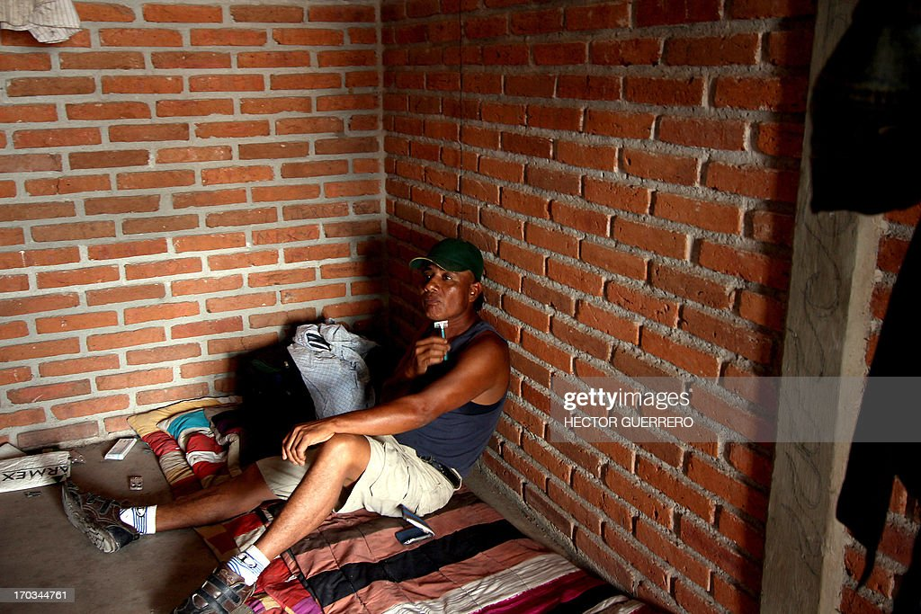 A man is seen shaving inside a tomato processing plant in Toliman, Jalisco state, Mexico on June 11, 2013. Some 270 workers were freed, after they were found living in poor conditions and deprived of their freedom. AFP PHOTO/Hector Guerrero