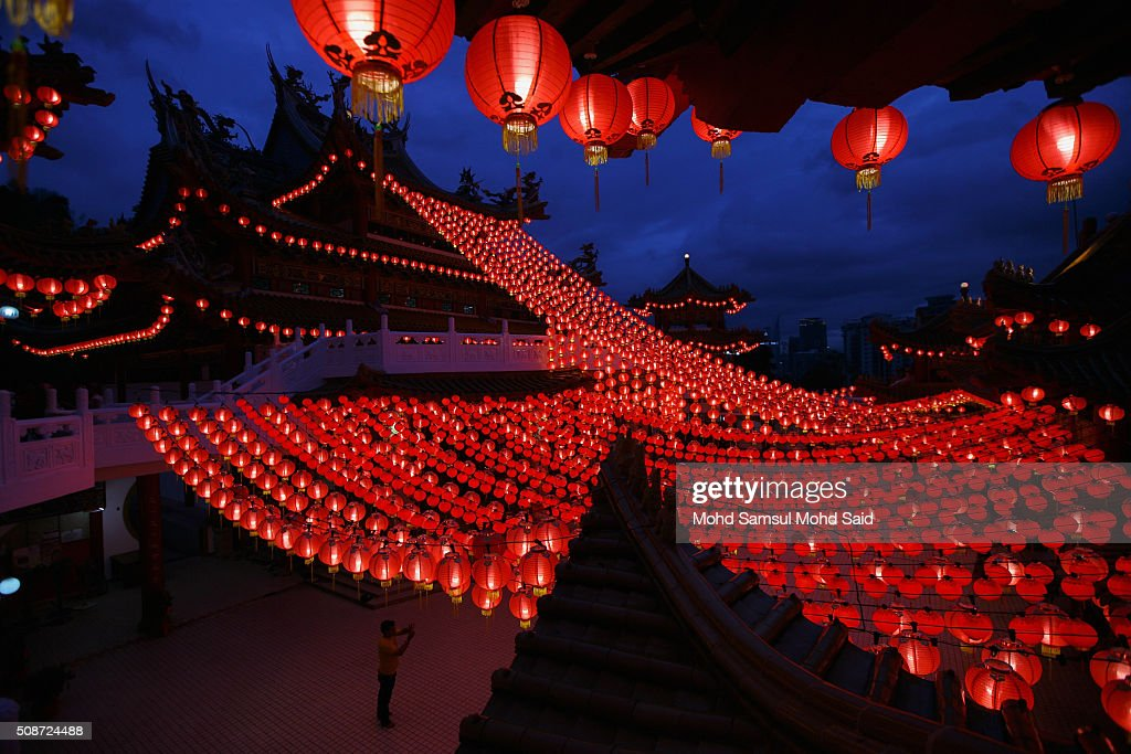 A man is seen take a picture inside the Thean Hou temple with lanterns decorated ahead of Lunar New Year of the monkey celebrations on February 6, 2016 in Kuala Lumpur, Malaysia. According to the Chinese Calendar, the Lunar New Year which falls on February 8 this year marks the Year of the Monkey, the Chinese Lunar New Year also known as the Spring Festival is celebrated from the first day of the first month of the lunar year and ends with Lantern Festival on the Fifteenth day.