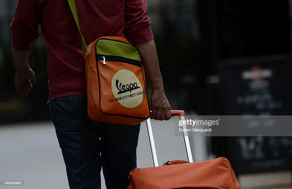 A man is seen wearing a Vespa satchel on June 11, 2014 in Barcelona, Spain.