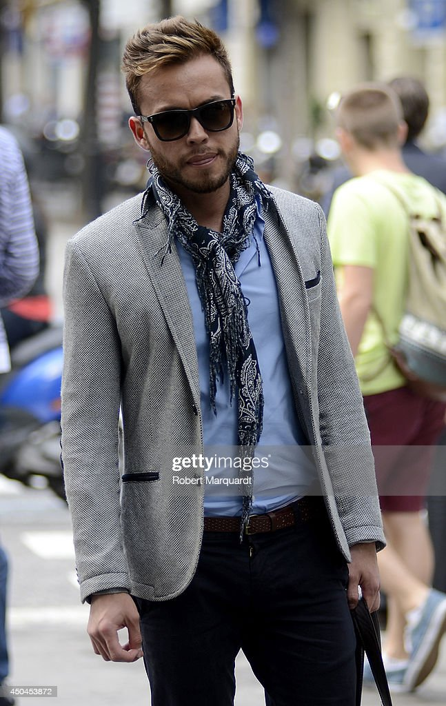 A man is seen wearing sunglasses by Rayban, a jacket by Pull and Bear with matching shirt and pants by Zara on June 11, 2014 in Barcelona, Spain.