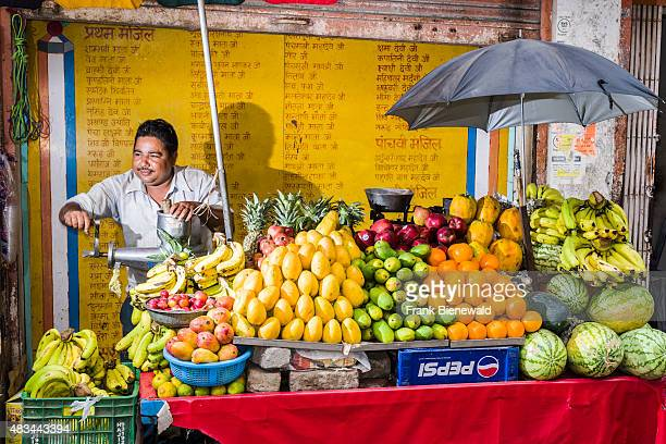 RISHIKESH UTTARAKHAND INDIA A man is selling fruits from a kart in the market