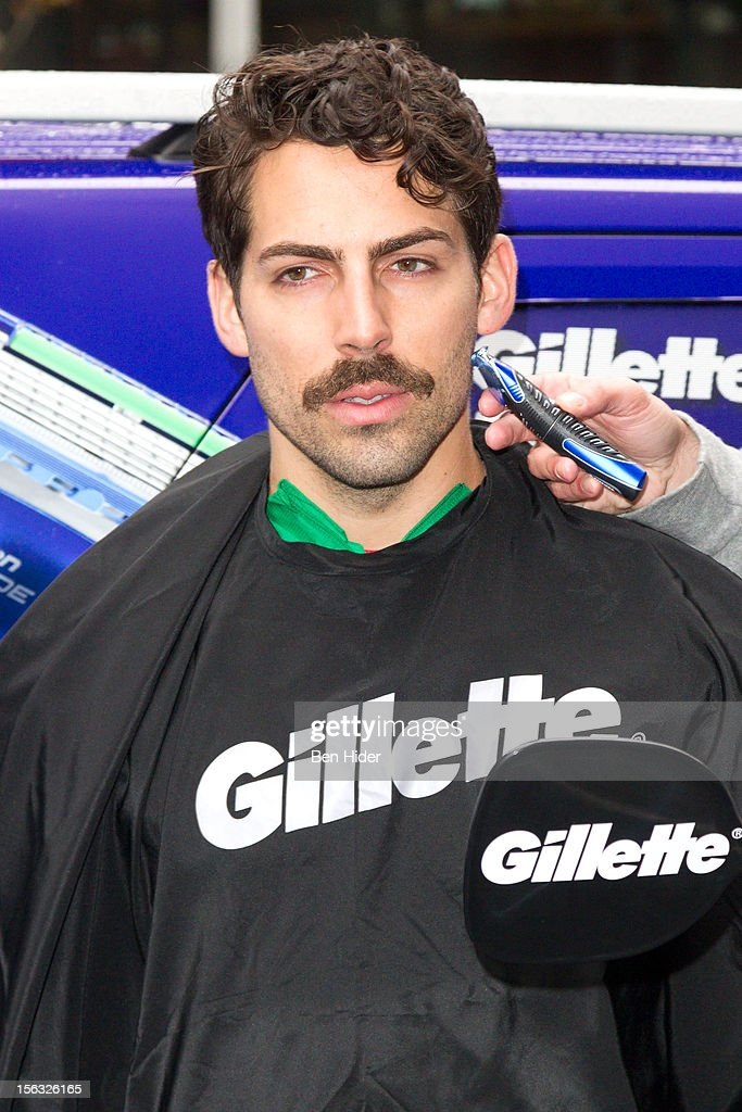 A man is shaved to create a moustache at the Gillette 'Movember' Event on November 13, 2012 in New York City.