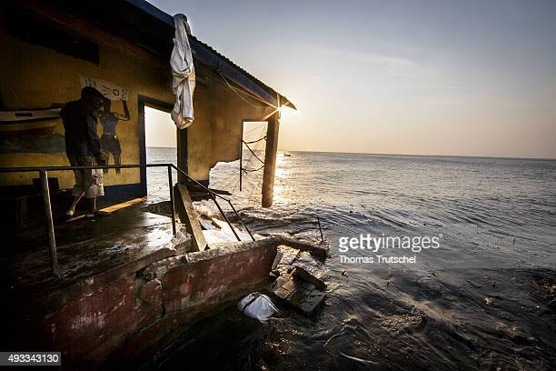 A man is standing in his house on the beach of Beira which was destroyed by the water on September 28 2015 in Beira Mozambique