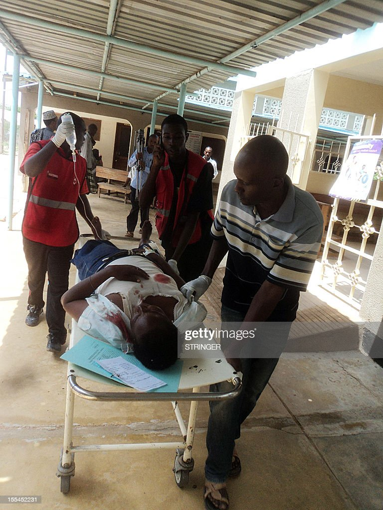 A man is stretchered as he arrives at the Garissa General Provincial Hospital, close to the border with Somalia, on November 4, 2012 after a grenade attack on a Kenyan churchthat left one policeman dead and 14 other people wounded. Kenya has seen a wave of grenade attacks on cities including the capital Nairobi and the key port of Mombasa since the country sent troops into Somalia in October last year to fight Al-Qaeda-linked Shebab insurgents.