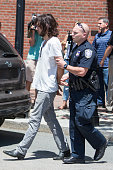 A man is taken into custody after a meat cleaver was found in his car in front of John Joseph Moakley United States Courthouse during the formal...