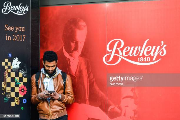A man is texting outside closed Bewley's Cafe Bewley's Oriental Café on Grafton Street has been closed for refurbishments for the last 21 months but...