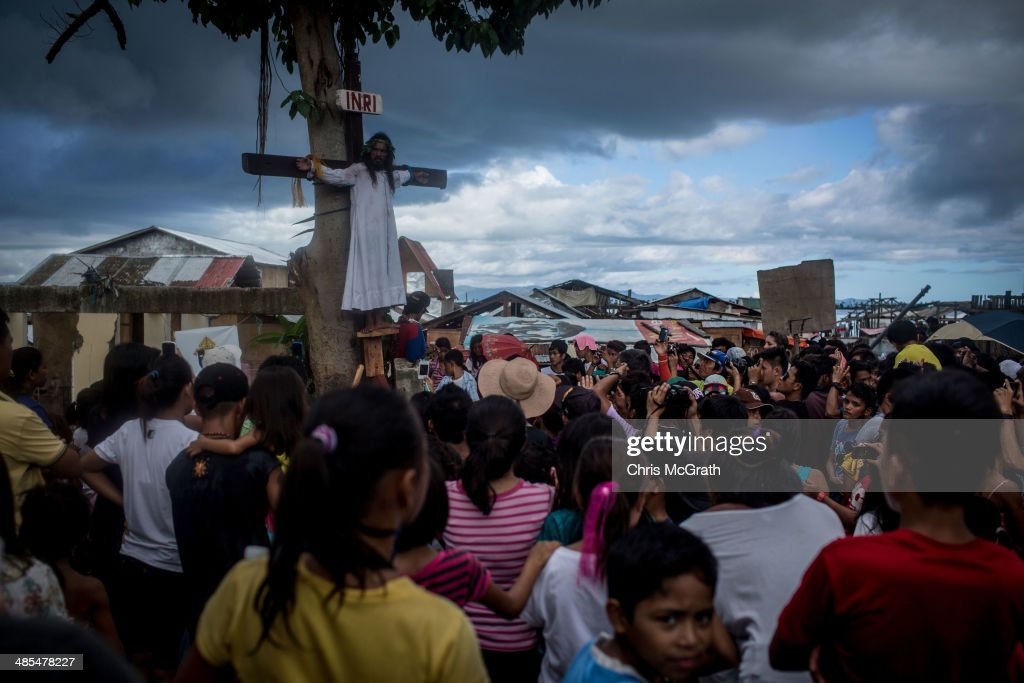 A man is tied to the cross during a re-enactment of the crucifixion of Christ, celebrated on Good Friday on April 18, 2014 in Tacloban, Leyte, Philippines. People continue to rebuild their lives five months after Typhoon Haiyan struck the coast on November 8, 2013, leaving more than 6000 dead and many more homeless. Although many businesses and services are functioning, electricity and housing continue to be the main issues, with many residents still living in temporary housing conditions due to 'No Build' areas preventing them from rebuilding their homes. This week marks Holy Week across the Philippines and will see many people attending religious activities.