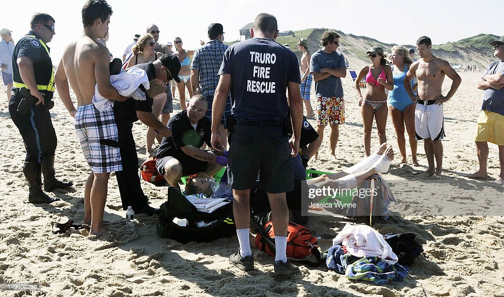 A man is treated for a shark bite on his legs at Cape Cod's Ballston Beach July 30, 2012 in Truro, Massachusetts. There have been numerous shark sightings off the Cape Cod coast this summer.