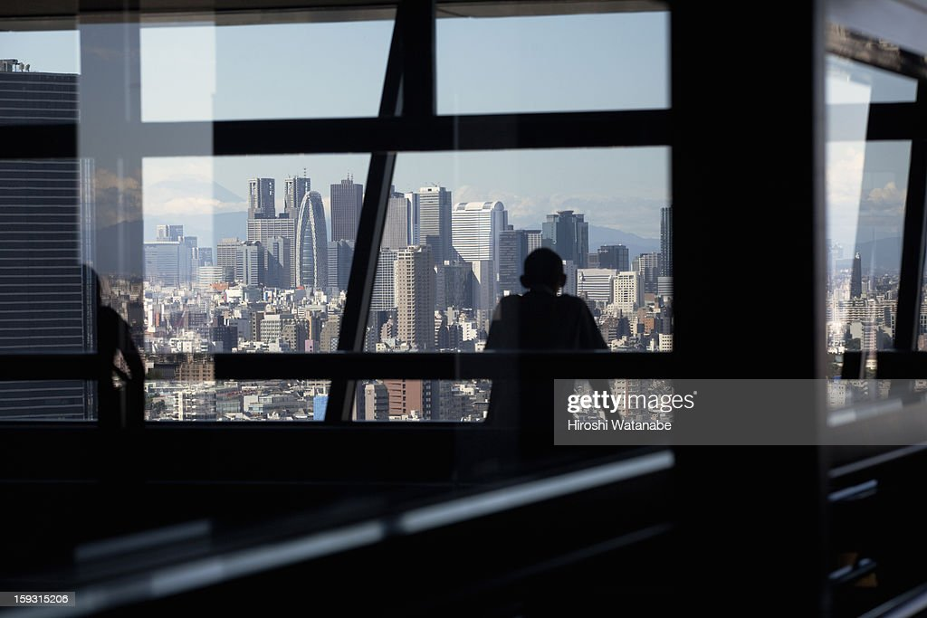 Man is viewing from the observatory : Stock Photo