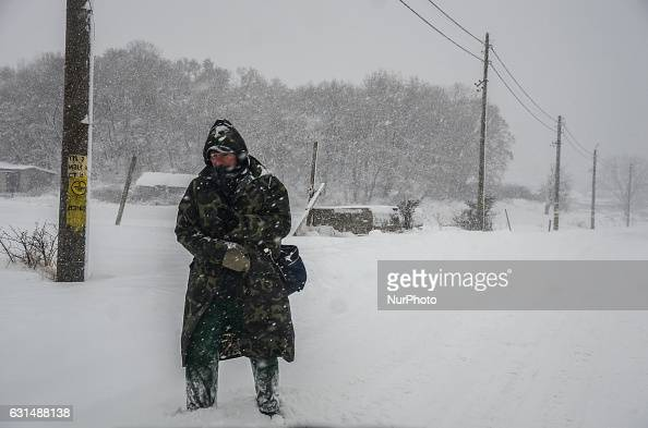 A man is walking as snow falls at the streets of Svilengrad Bulgaria on January 11 2017 Snow paralyse Bulgaria The snow reached 40 70 sm at different...