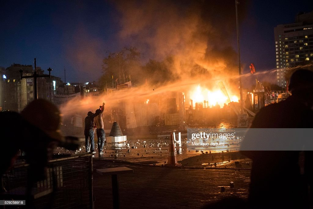 A man is water cannoned as fires break out from teargas cannisters Protesters rally around and throw rocks at the police As the police attempt to...