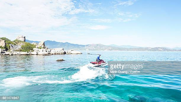 Man Jet Boating In Sea Against Sky