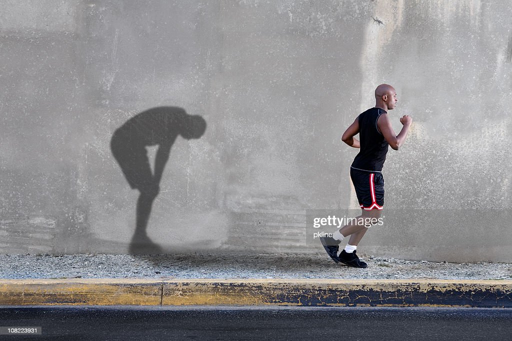 Man Jogging and Tired Shadow : Stock Photo