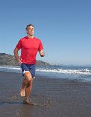 Man jogging at beach