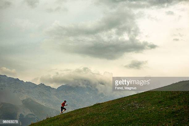 A man jogging in the mountains, Italy.