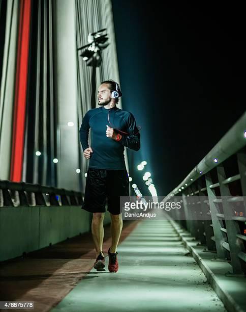 man jogging late at night