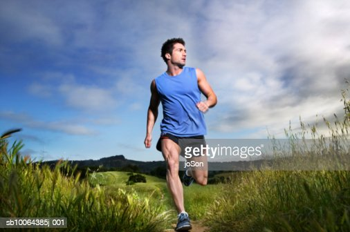 Man jogging, looking away : Stock Photo