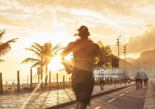 Man jogging on the beach of Ipanema at sunset