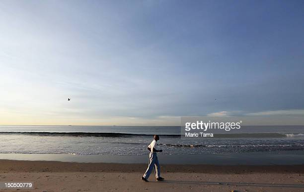 A man jogs at Rockaway Beach on August 19 2012 in the Queens borough of New York City Over the last few years the Rockaways peninsula has become an...