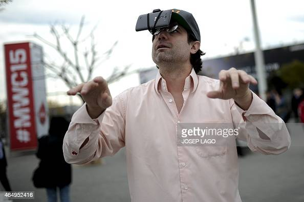 A man jokes with a mobile phone tied to his glasses during opening day of the 2015 Mobile World Congress in Barcelona on March 2 2015 Phone makers...