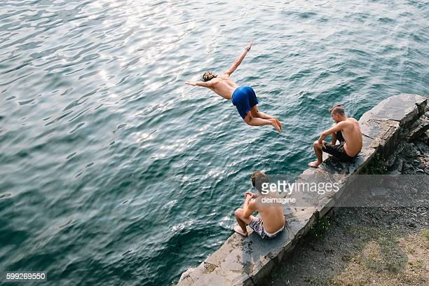 Man jump and dive in the water