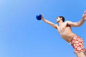 Man jumping and hitting volley ball