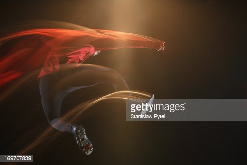 Man jumping and leaving light streaks