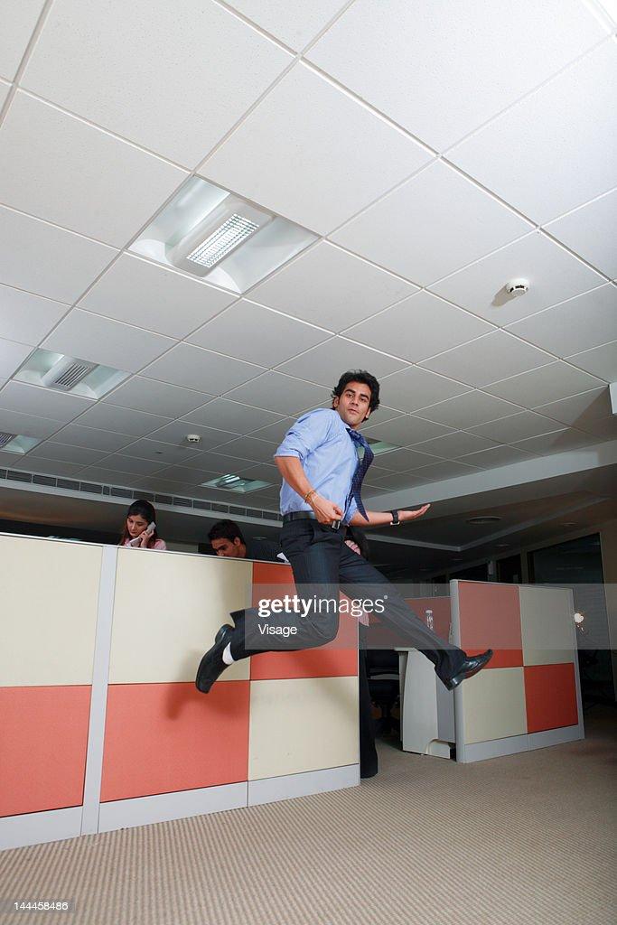 Man jumping at office : Stock Photo