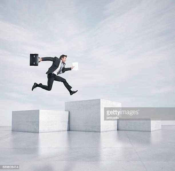 Man jumping at pedestals