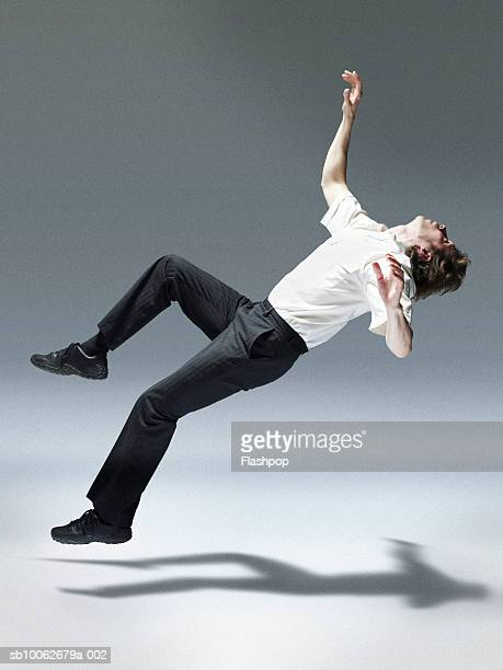 Man jumping backwards, side view