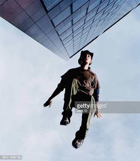 Man Jumping by Skyscraper