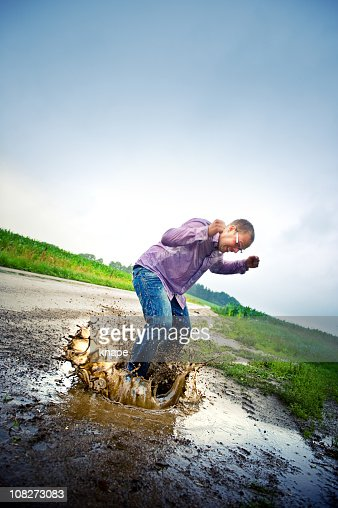 man jumping in a pool of water