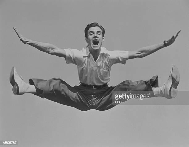 Man jumping in air, doing split (B&W)
