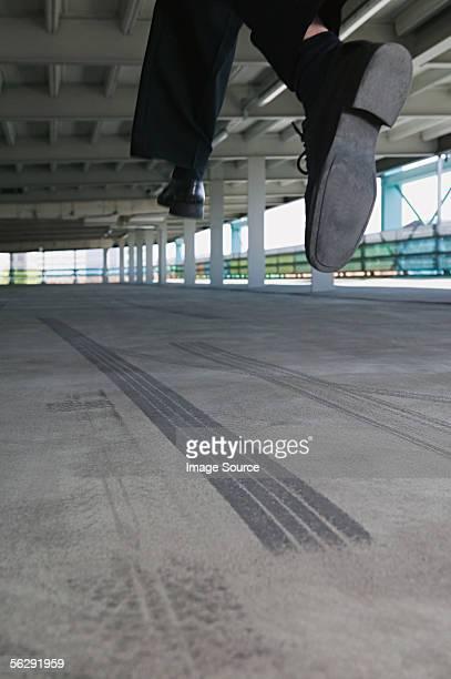 Man jumping in car park