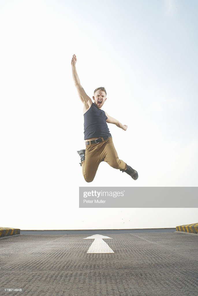 Man jumping in road : Stock Photo