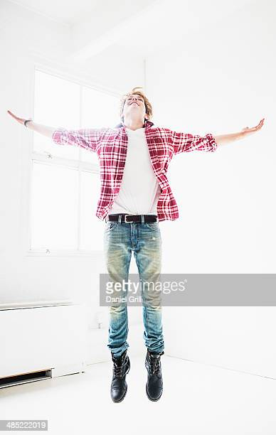 Man jumping in room