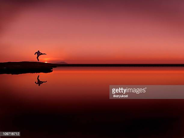 A man jumping in the air with sunset background