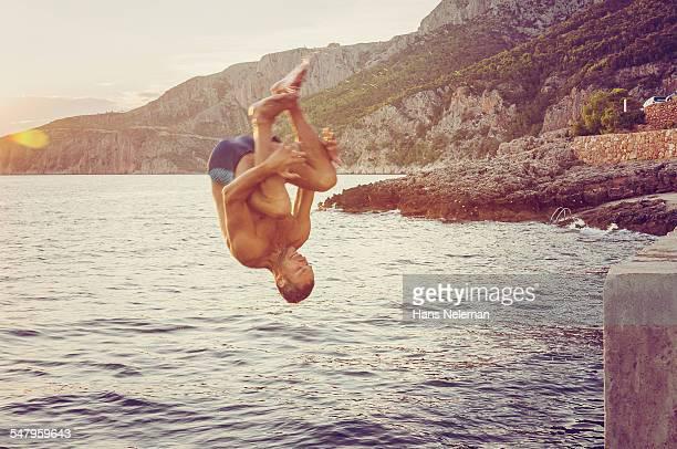 Man jumping into sea